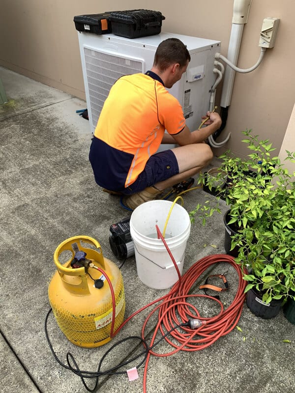 Removing the old refrigerant for recycling