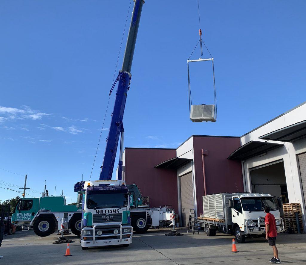 crane lifting aircon unit