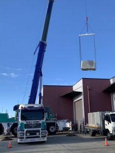crane lifting aircon unit scaled e1627535723351